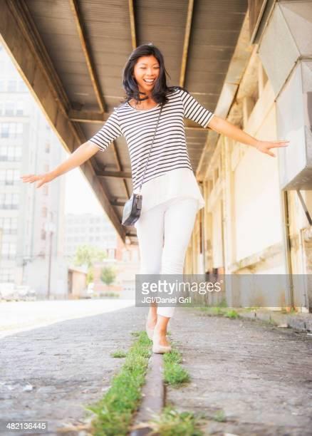 Chinese woman walking on urban street