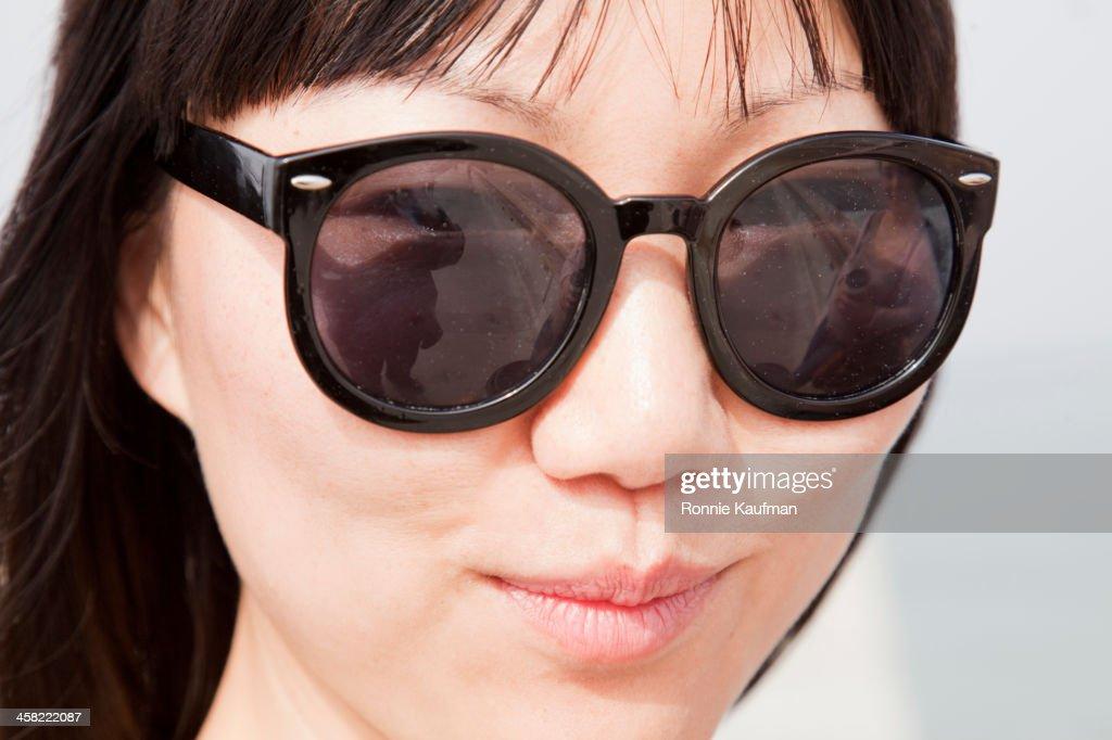 Chinese woman wearing sunglasses : Stock Photo