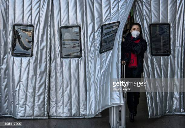 Chinese woman wears a protective mask as she leaves a Beijing railway station on January 23 2020 in Beijing China The number of cases of a deadly new...