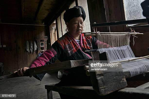 Chinese woman weaving fabric, Longsheng Village, Guilin, China