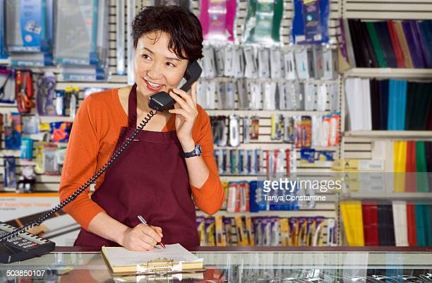 Chinese woman working in office supply store