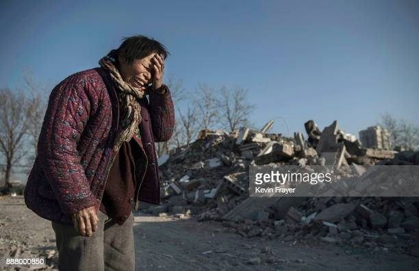 Chinese woman Zheng Yuzhi whose apartment was demolished by authorities three months ago and is now homeless cries as she tells her story near...