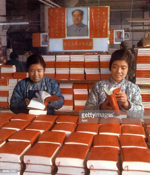 Chinese women at Sinhoua printing works in Pekin looking at exemplaries of The Little Red Book 1968