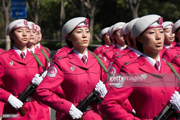 chinese women militia soldiers marching of the military parade - paramilitary stock photos and pictures