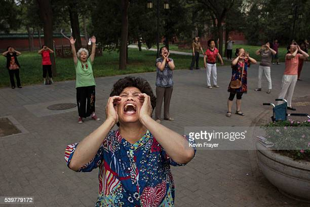 Chinese women shout as they do voice exercises at Ritan Park on June 12 2016 in Beijing China Ritan meaning 'sun altar' is among the oldest parks in...