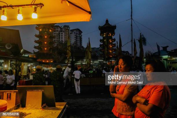 Chinese women waits thier food at mini shop during The Nine Emperor Gods Festival inside the temple on October 27 2017 in Kuala Lumpur Malaysia The...