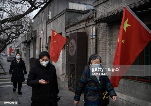 Chinese women wear protective masks on the street during the Chinese New Year and Spring Festival holiday on January 28 2020 in Beijing China The...