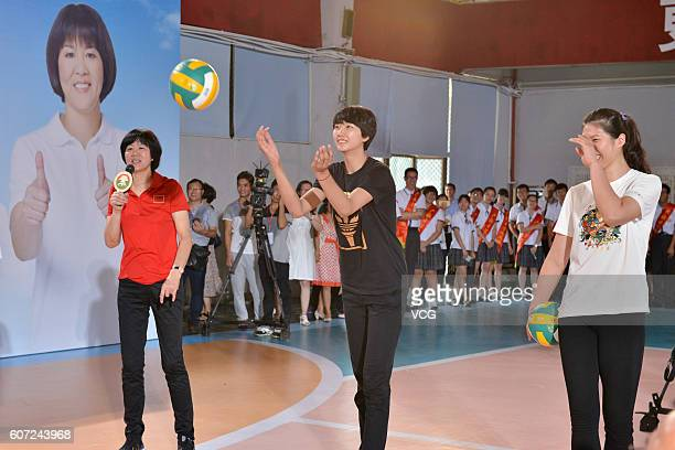 Chinese women's volleyball head coach Lang Ping guides while players Yuan Xinyue and Xu Yunli demonstrating volleyball during their visit Guangya...