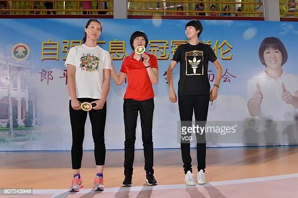 Chinese women's volleyball player Xu Yunli head coach Lang Ping and player Yuan Xinyue visit Guangya High School on September 17 2016 in Guangzhou...