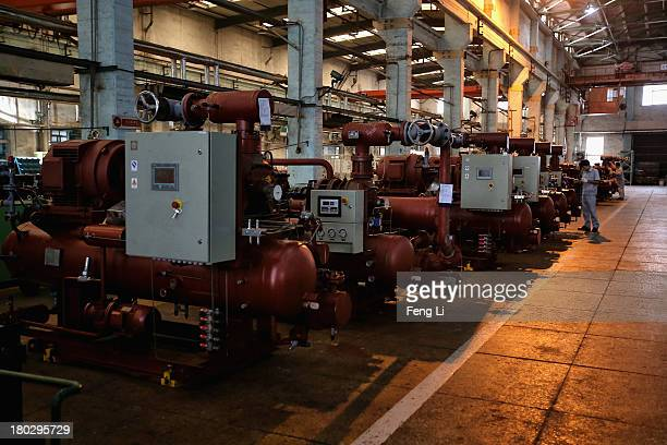 Chinese worker checks the refrigeration compressors at China's largest refrigeration industrial enterprises Dalian Bingshan Group Co Ltd on September...