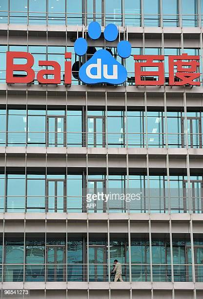 A Chinese worker cleans the balcony of Chinese Web search giant Baidu's headoffice in Beijing on February 10 2010 The Nasdaqlisted Baidu said net...
