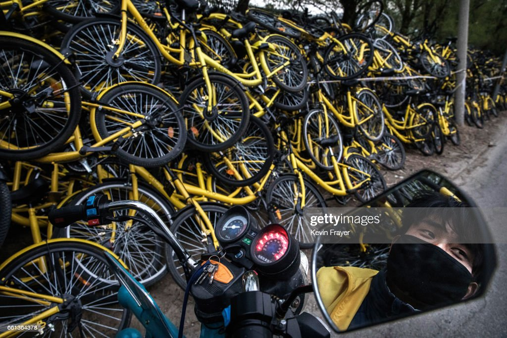 A Chinese worker from bike share company Ofo Inc. brings damaged bicycles collected from the streets at a repair depot for the company on March 30, 2017 in Beijing, China. The popularity of bike shares has exploded in the past year with more than two dozen providers now battling for market share in major cities across China. The bikes are hailed as an efficient, cheap, and environmentally-friendly solution for commuters, where riders unlock the stationless bicycles using a mobile phone app, drop them anywhere for the next user, and spend as little as 1 yuan ($0.15) per hour. Given the bikes have several users a day - some of them inexperienced riders who swerve into traffic - they are often damaged, vandalized, or abandoned. Companies like Ofo routinely collect the battered two-wheelers and bring them to a makeshift depot that is part repair shop, part graveyard where they are either salvaged or scrapped. The bike shares are powering a cycling revival of sorts in a country once known as the 'Kingdom of Bicycles'. In the early years of Communist China, most Chinese aspired to own a bicycle as a marker of achievement. When the country's economic transformation made cars a more valued status symbol, the bicycle - a Chinese cultural icon - was mocked as a sign of backwardness. The bike share craze is also a boon for manufacturers who are now mass producing over a million bikes a month to meet demand, and the number of shared bike users will reach 50 million in China by the end of the year, according to Beijing-based BigData Research. Not everyone is cheering the revival though, as municipal officials are drafting new regulations to control the chaotic flood of bicycles on streets and sidewalks.