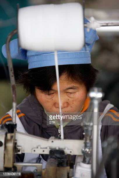 A Chinese worker goes about her chores at a textile factory in Huaibei east China's Anhui province on November 21 2011 China's manufacturing activity...