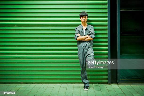 chinese worker in industrial area - coveralls stock pictures, royalty-free photos & images