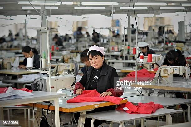 A Chinese worker looks on from her work station at a garment factory in Pinghu some 100 kms from Shanghai on April 10 2010 China posted its first...