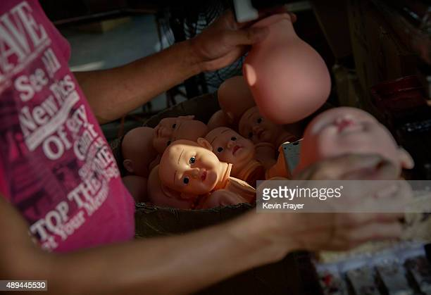 Chinese worker prepares doll heads to be painted at a toy factory on September 17 2015 in Xietang Zhejiang ProvinceChina Many of the toy factories in...