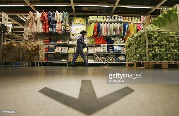 Chinese worker prepares the newly completed IKEA Siyuanqiao store ahead of its opening on April 10 2006 in Beijing China The world's leading home...