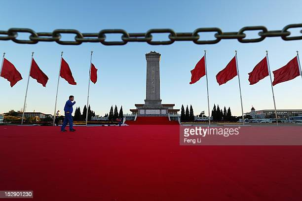 Chinese worker walks on the red carpet at the Tian'anmen Square on September 28 2012 in Beijing China The 18th National Congress of the Communist...