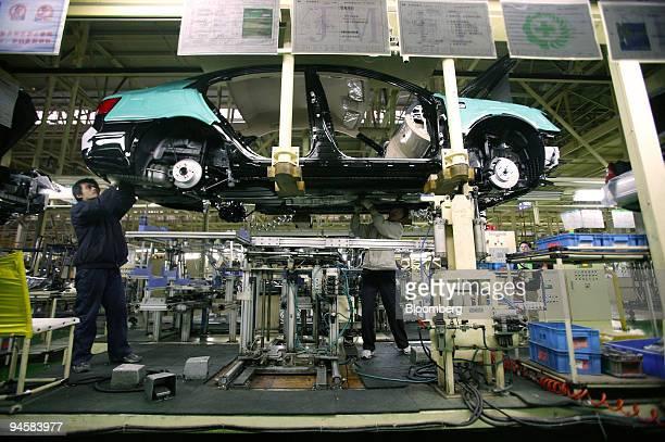 Chinese workers assemble Hyundai vehicles at Beijing Hyundai's automobile production plant in Beijing China China Friday November 17 2006 China's...