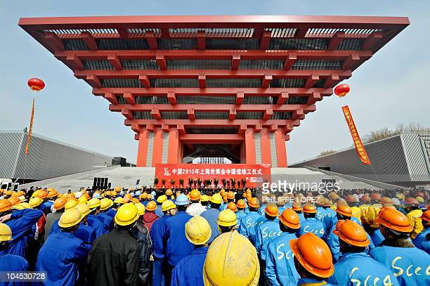Chinese workers attend the completion ceremony of the Chinese pavilion at the site of the World Expo 2010 in Shanghai on February 8, 2010. Less than...