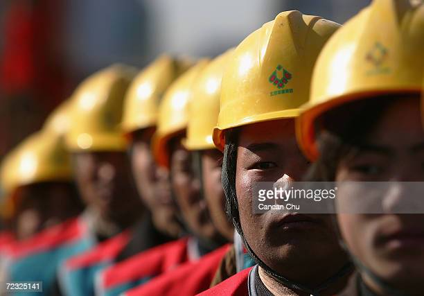 Chinese workers attend the opening ceremony of Beijing's Wukesong Basketball Stadium, the venue for the 2008 Olympic basketball competiton, on March...