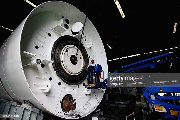Chinese workers check the tunnel engineering equipment at Northern Heavy Industries Group Co Ltd on September 9 2013 in Shenyang of Liaoning Province...