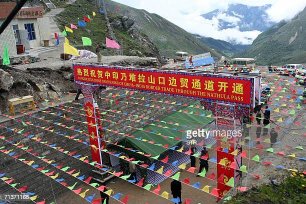 Chinese workers decorate the Chinese side of the border of Nathu La some 52 kilometres east of Gangtok 05 July 2006 Formal trading is due to begin at...