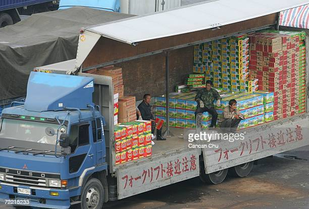 Chinese workers load goods on to North Korean Vehicles on October 19, 2006 in the Chinese border city of Dandong, Liaoning Province of China. Customs...