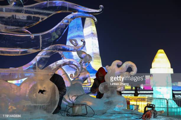 Chinese workers makes an ice sculpture during the Harbin Ice and snow world on January 3 2020 in Harbin Heilongjiang Province China The Ice and Snow...