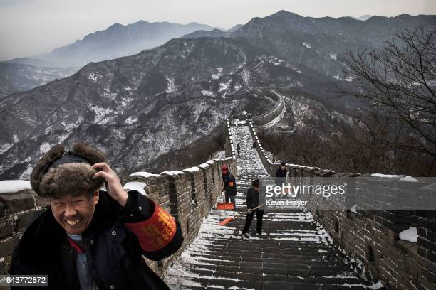 Chinese workers shovel the steps after a snowfall on the Great Wall in Mutianyu on February 22 2017 outside of Beijing China