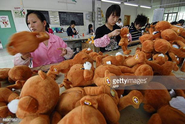 Chinese workers stitch teddy bears at the PP Bear Toy Company located in the southern Chinese city of Shenzhen on November 24 that would have been...