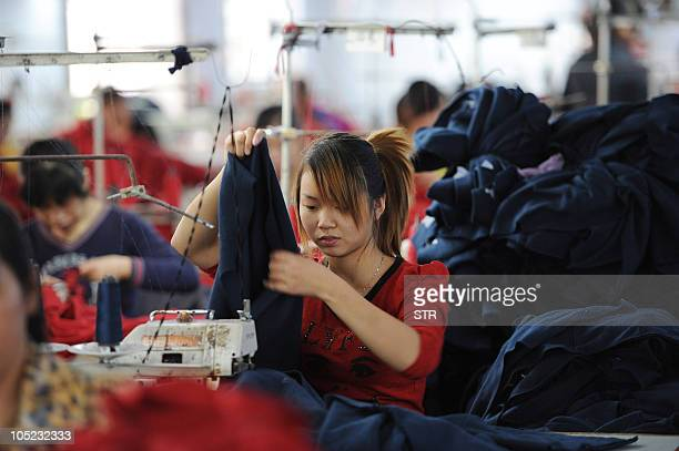 Chinese workers stitch various clothes for export to Europe at a textile factory in Hefei in eastern China's Anhui province on October 12 2010...