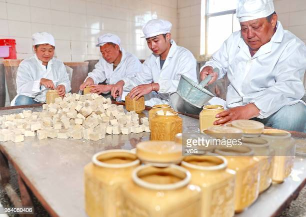 Chinese workers use traditional way to make white fermented tofu on May 3 2018 in Qinhuangdao Hebei Province of China