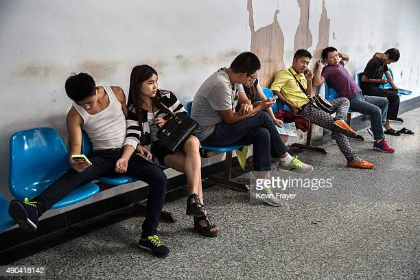 Chinese workers wait for job opportunities inside a local employment center on September 18 2015 in Yiwu Zhejiang Province China A slowdown in...