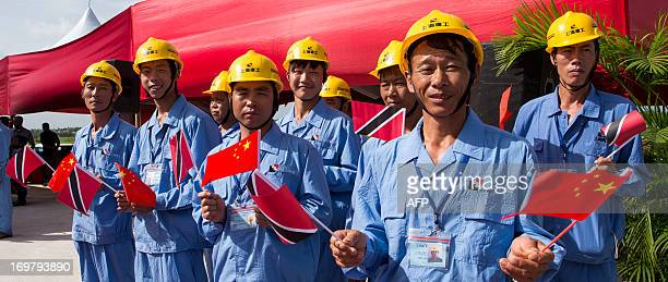 Chinese workers wait for the arrival of Chinese President Xi Jinping at the site of the Couva Children´s Hospital in Port-of-Spain, Trinidad and...