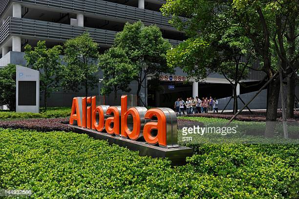 Chinese workers walk out from the Alibaba head office building in Hangzhou in eastern China's Zhejiang province on May 21 2012 Alibaba China's top...