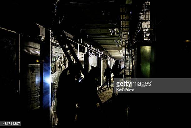 Chinese workers work on the platform area of a new subway line on March 29 2014 in Beijing China The new line will be the 18th in the Beijing subway...