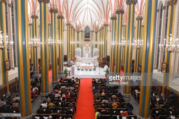 Chinese worshippers attend a mass during the Christmas Eve at a Catholic church in Beijing on December 24 2018