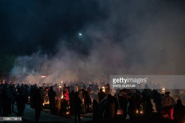 Chinese worshippers offer prayers and burn incense on the fifth day of the Lunar New Year at the Guiyuan Buddhist Temple in Wuhan central China's...