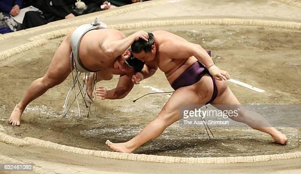 Chinese wrestler Sokokurai throws Mongolian wrestler Takanoiwa to win during day fifteen of the Grand Sumo New Year Tournament at Ryogoku Kokugikan...