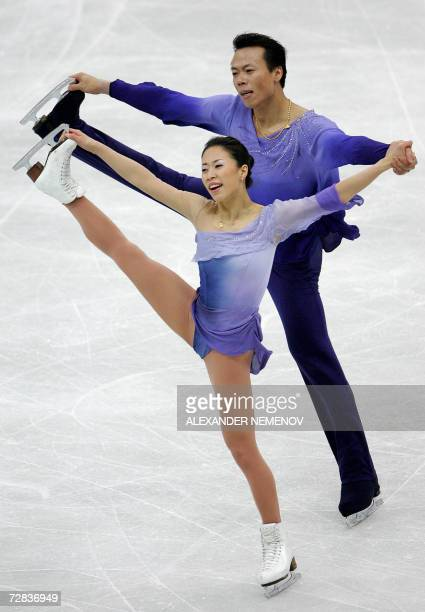 Chinese Xue Shen and Hongbo Zhao perform for the first place during pair's free skating program at ISU Grand Prix Figure Skating final in St....
