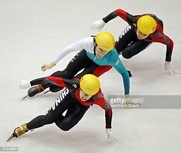 Chinese Yang Yang Bulgarian Evgenia Radanova and Chinese Chunlu Wang skate during the ladies 500m final short track race at the Olympic Ice Center 16...