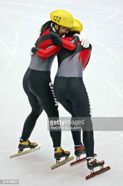 Chinese Yang Yang congratulates her compatriot Chunlu Wang after the ladies 500m final short track race at the Olympic Ice Center 16 February 2002...