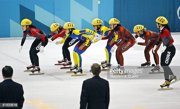 Chinese Yang Yang is pushed by her compatriot Chunlu Wang MinJin Joo of South Korea is pushed by her compatriot HyeWon Park Canadian Isabelle Charest...