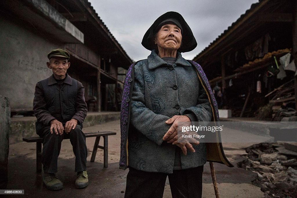 Chinese Yi minority villagers Qiu Kaibin, 75, left, and Mao Guixiang, 77, stand outside their farmhouse in the hills below the 7,556 m (24,790 ft) Mount Gongga, known in Tibetan as Minya Konka on November 12, 2015 in Hailuogou, Garze Tibetan Autonomous Prefecture, Sichuan province, China. Hailuogou is one of China's 8,500 monsoonal glaciers and the longest of 71 glaciers on the eastern slope of Mt. Gongga. Monsoonal glaciers are found at lower altitudes and are at much higher risk to the effects of rising temperatures and climate change. Chinese scientists studying the impact on the Tibetan plateau warn the ablation rate of monsoonal glaciers is alarming. Data shows the Hailuogou basin glaciers have lost nearly 3 kilometers of mass since the 1960s and the rate is accelerating. Some researchers are concerned the glaciers could shrink at an accelerated rate beyond the present 20 meters a year and thin at a rate of more than 1 meter per year. At an upcoming conference in Paris, the governments of 196 countries will meet to set targets on reducing carbon emissions in an attempt to forge a new global agreement on climate change.