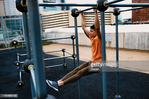 chinese young man exercising on cloudy day, doing push ups - sports training stock pictures, royalty-free photos & images