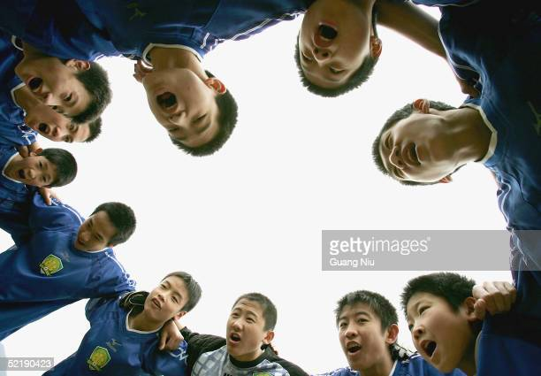Chinese young soccer players give a cheer during a training course on February 11 2005 in Qingyuan Guangdong province China More than one thousand...