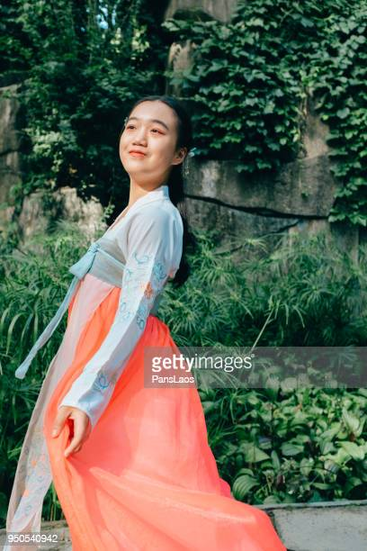 Chinese young teenage girl in traditional dancing outdoor