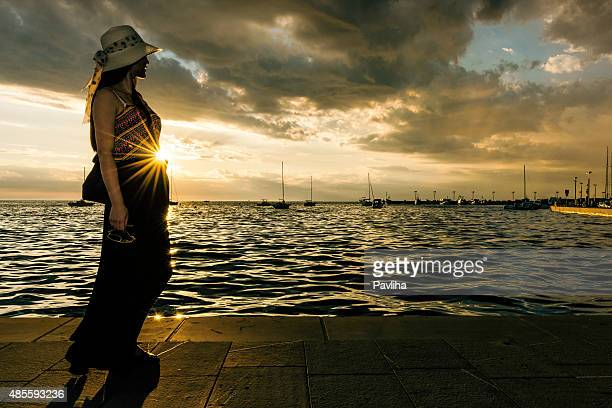 chinese young woman enjoying the sunset at sea, koper,slovenia - koper stock photos and pictures