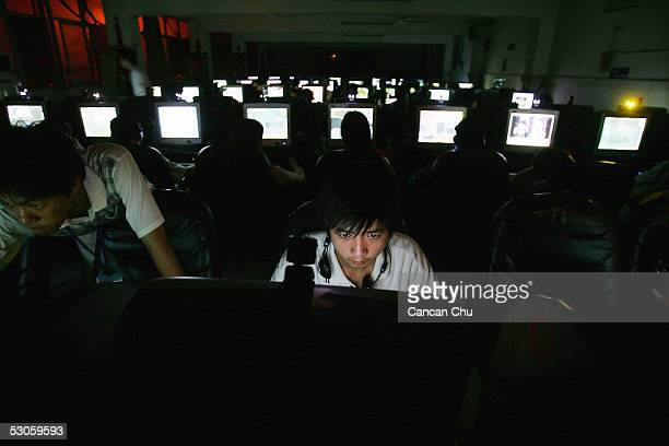 Chinese youngsters play online games overnight at an internet cafe on June 11 2005 in Wuhan Hubei Province of China There are near 2000 internet...